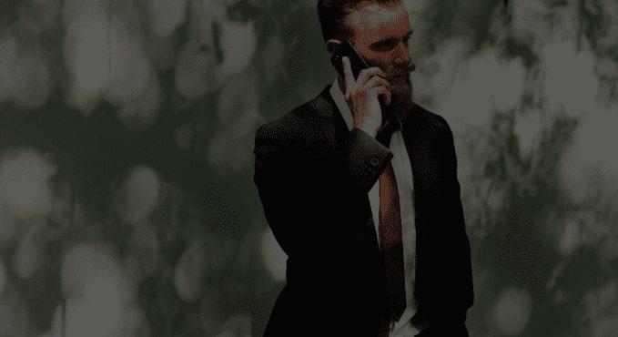 Rich man holding a phone